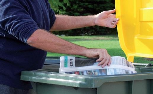 Person placing paper in bin