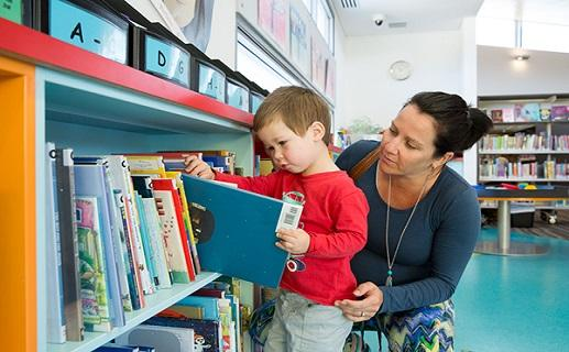 Lady and child in library