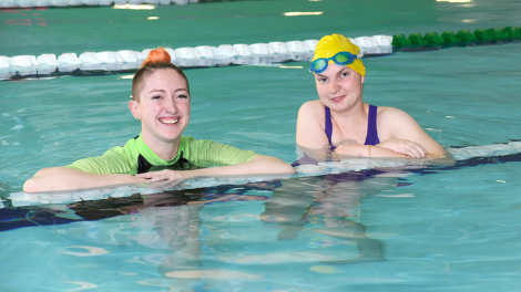 Dolphins Program swimmer Beth Langford, with Wanneroo Aquamotion swim instructor Danielle Lysle, is looking forward to the upcoming Dolphins Olympics.