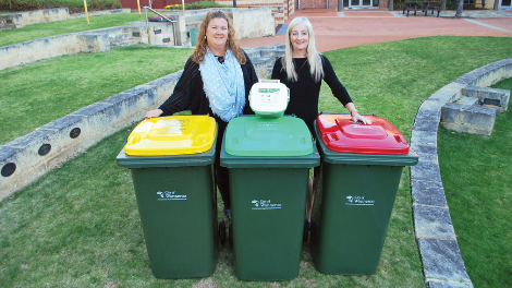 Mayor Tracey Roberts and Deputy Mayor Natalie Sangalli demonstrating how the new three-bin system will work.