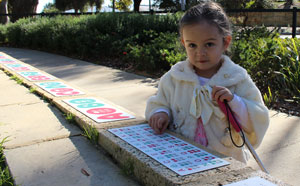 Girl with braille signage