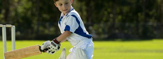 Child playing cricket