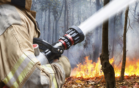 Fireman fighting fire