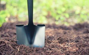 Image of mulch and spade.