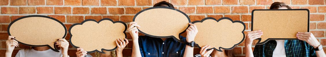 Image of people holding up speech bubbles