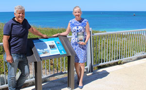 Wanneroo Mayor Tracey Roberts with George Bartell, owner of The Shore Café, in front of the newly installed signage at Alkimos. Mr Bartell was instrumental in getting the shipwreck signage project underway.