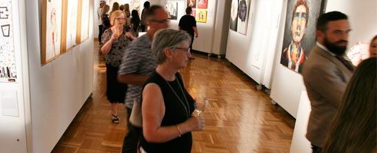 People at gallery viewing art