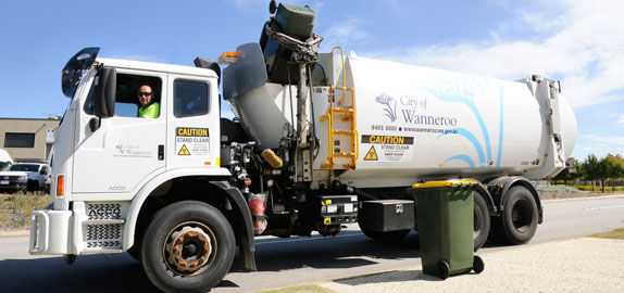 Waste truck collecting rubbish