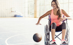 Woman in wheelchair playing basketball