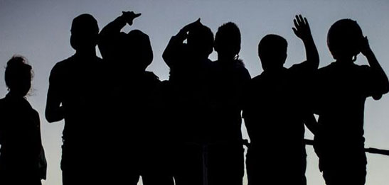 Group of children in silhouette