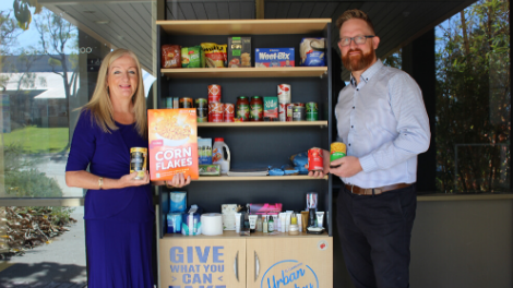 Wanneroo Mayor Tracey Roberts meets with volunteer Tim Nickoll to make a donation to the Wanneroo Urban Pantry.