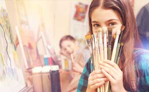 Girl with paintbrushes