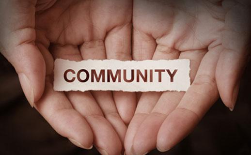Hand holding community sign