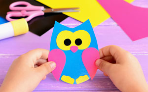 Bird craft with paper and scissor and glue