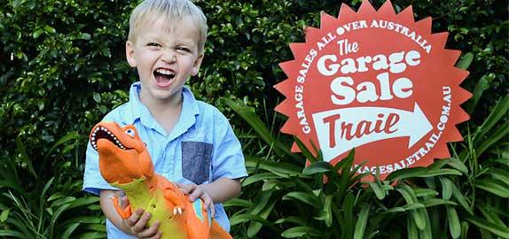 Child at garage sale trail event
