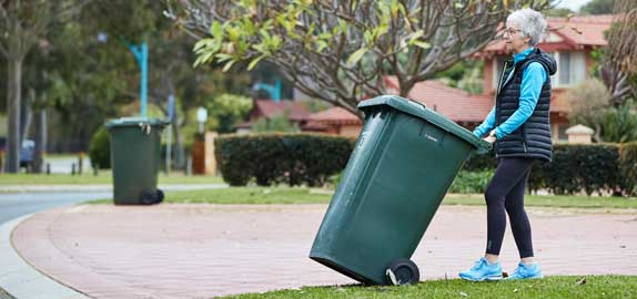 Resident putting bin out for collection