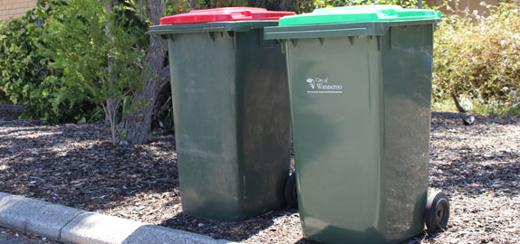 Red and green lid City of Wanneroo bins