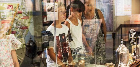 Children viewing museum display