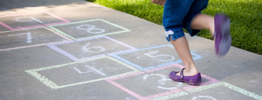 Child playing hopscotch