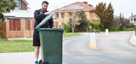 Resident using bin