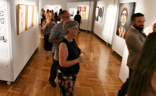 People at gallery exhibition