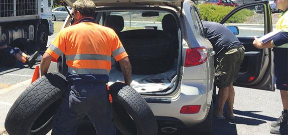 Man disposing of tyres