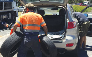 Man disposing of car tyres