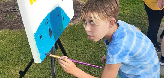Boy doing painting